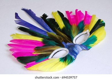 a colorful feather mask isolated on white background
