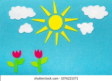 Colorful felt background with sun, clouds and tulip flowers, copy space