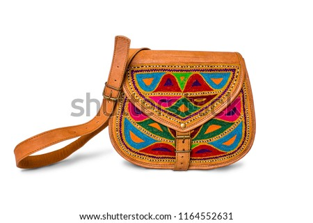 Colorful female cute leather handbag isolated on white background. Indian  design handmade leather bag for 83dc073fd00e4