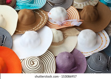 Colorful female summer hats lie on the counter