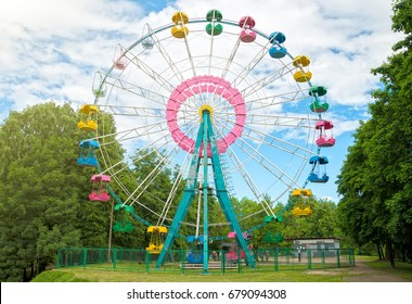 Colorful ferris wheel in the city park.