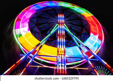 Colorful Ferris wheel at Thai temple fair