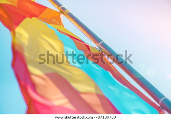 Colorful festival flags on clear blue sky summer background