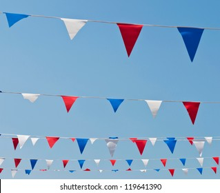 colorful festive bunting flags against a blue sky background (United Kingdom)