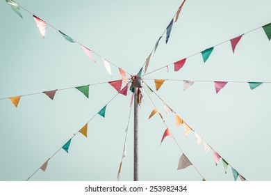 colorful festive bunting flags against, vintage style.