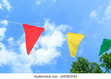 Colorful festive flags against the blue sky