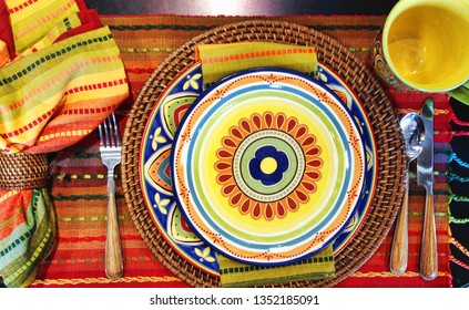 Colorful fiesta plates and tablecloth