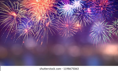 Colorful firework with bokeh background with copy space for New Year celebration, Abstract holiday background