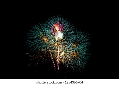 Colorful firework festival on black background.
