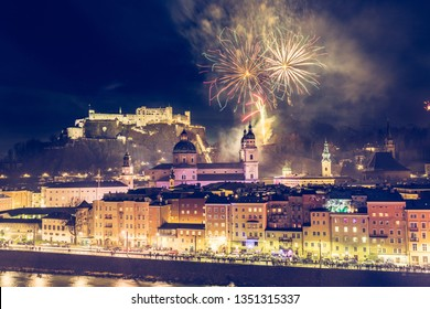 Colorful firework in the night: Old city of Salzburg and Festung Hohensalzburg at New Year's Eve. Magic