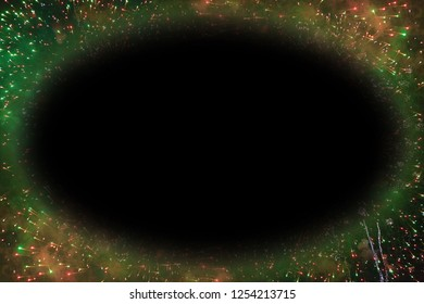 Colorful fireworks with black oval copy space glowing edges in the middle