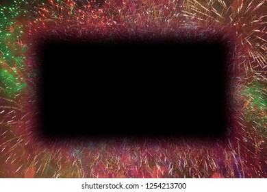Colorful fireworks with black rectangle glowing edges copy space in the middle