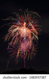 Colorful fireworks bursting in the night sky. Graphic material for events and celebrations.