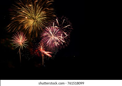 Colorful fireworks celebration and the midnight sky background.