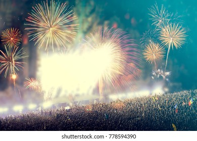 Colorful fireworks and crowd celebrating the New Year