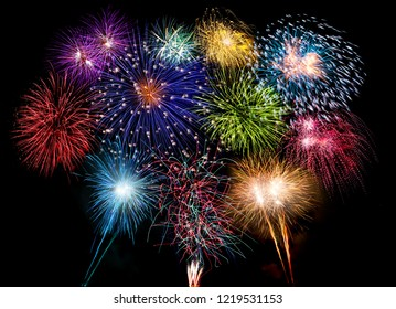 colorful fireworks display and bright sparkler pyrotechnic number 2019 happy new year sylvester concept on black blue background