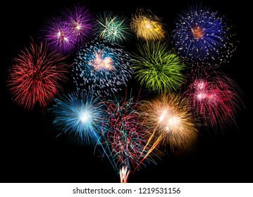 colorful fireworks display and bright sparkler pyrotechnic happy new year sylvester concept on black blue background