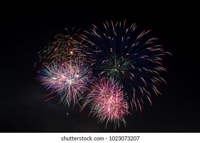 Colorful fireworks display at holiday night.