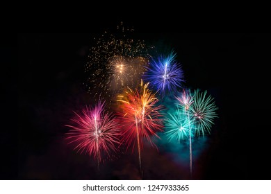 Colorful fireworks display on dark background