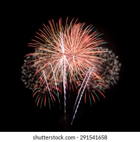 Colorful fireworks exploding in the night sky