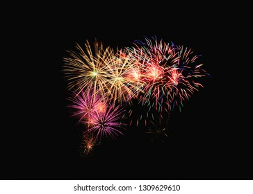 Colorful fireworks explosion in festive celebration, isolated on black background