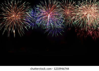 Colorful of fireworks in holiday new year festival on black sky.