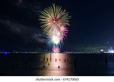 colorful fireworks in a night sky over ocean in Texas