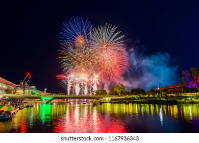 Colorful fireworks on Australia Day celebration in Elder Park viewed across Riverbank at night