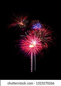 Colorful fireworks on black background.