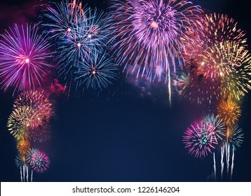 colorful fireworks on the black sky background with free space for text. Celebration and anniversary concept