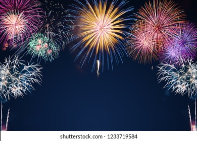 colorful fireworks on the black sky background over-water