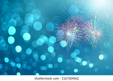 colorful fireworks on blue bokeh background