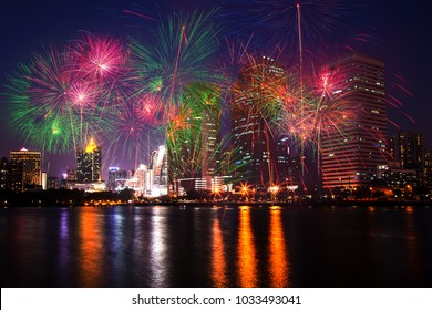 The colorful fireworks on city, urban and lake in the night as beautiful background concept