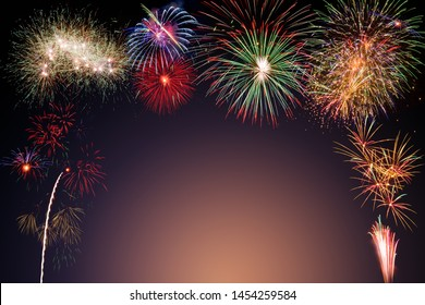 colorful fireworks on dark blue and orange background