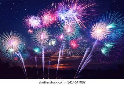 colorful fireworks on the night sky background.