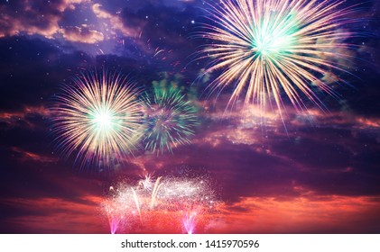 colorful fireworks on night sky background.