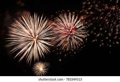 Colorful fireworks over dark sky, displayed during a celebration. Holiday. Night fireworks. Holiday. Night fireworks