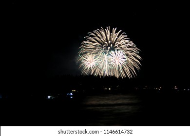 Colorful fireworks over a lake