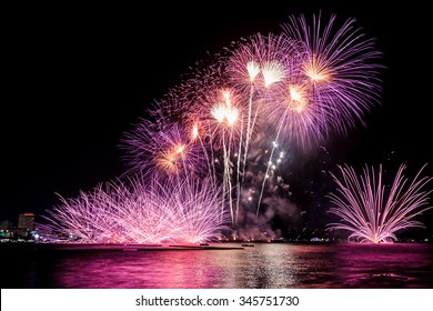 Colorful fireworks over the water on the Pattaya beach , Thailand
