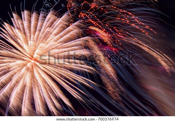 Colorful fireworks, as pink peony and sparks. Colored firework holiday background