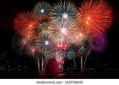 Colorful fireworks of various colors at night with celebration and anniversary concept.