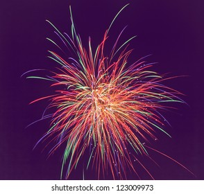 Colorful fireworks of various colors over dark sky. soft focus.