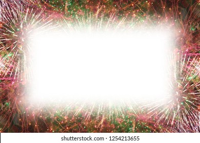 Colorful fireworks with white rectangle copy space in the middle