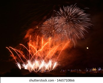 Colorful fireworks in Zurrieq,2019, Malta with house lights in the background,explode, dark sky background and house light. Malta.Maltese fireworks.Pyrotechnics show. Traditional feast in Malta