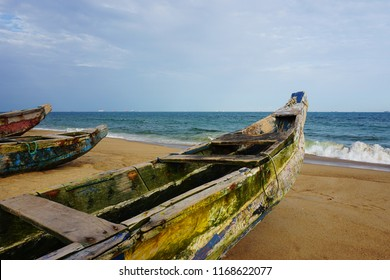 Colorful fisher boats lying on the sand at the beach of lome in Togo