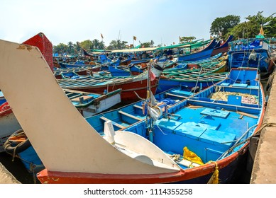 Colorful fishing boats anchored in the Kannur dock, Kerala, India.