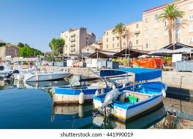 Colorful fishing boats moored in old port of Ajaccio, South Corsica, France
