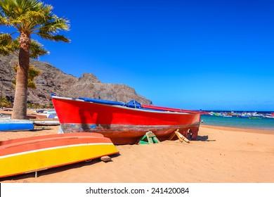 Colorful fishing boats on beach Playa de las Teresitas, Tenerife island, Spain