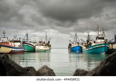 Colorful fishing vessels hiding from a powerful incoming storm in St Helena Bay - South Africa