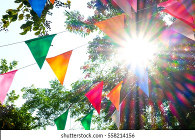 colorful flag festival celebrate in garden blurred background
